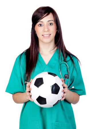 medicine ball: Attractive brunette doctor with soccer ball isolated on a over white background