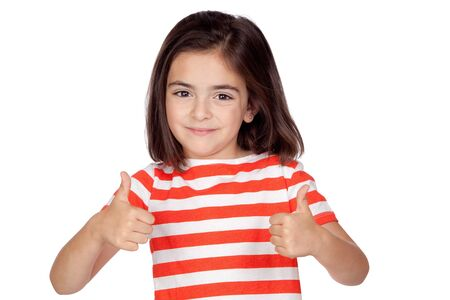 Brunette little girl saying Ok isolated on a over white background photo