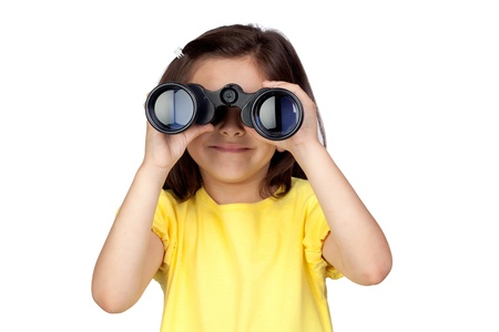 Brunette little girl looking through binoculars isolated on a over white background photo