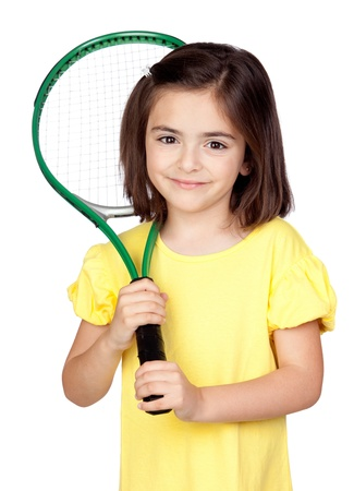 Brunette little girl with a tennis racket isolated on a over white background