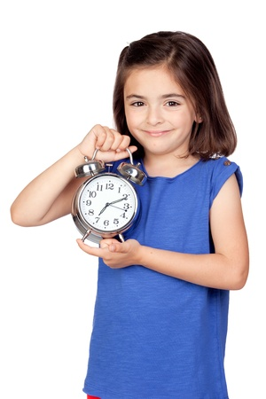 silvered: Brunette little girl with a silvered alarm-clock a isolated on a over white background