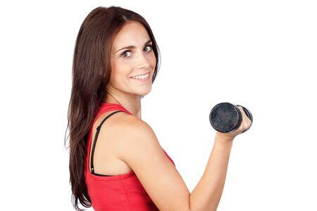 Chica atractiva haciendo gimnasia con pesas aisladas sobre fondo blanco Foto de archivo - 9788980