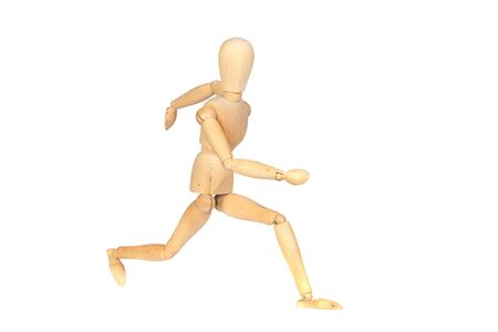 similitude: Jointed wooden mannequin running isolated on white background Stock Photo