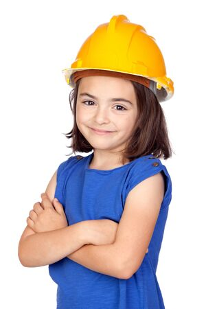 Brunette little girl with a yellow helmet isolated on a over white background photo