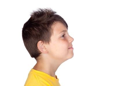 Profile of happy child isolated on white background photo