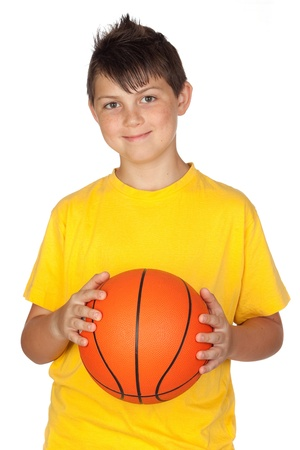 Beautiful child with basket ball isolated on white background photo