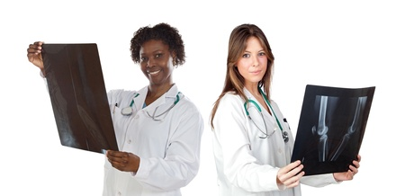 Two woman doctor with radiography a over white background Stock Photo - 10376523