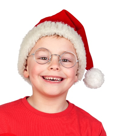 Adorable child with Santa Hat and glasses isolated on white background photo