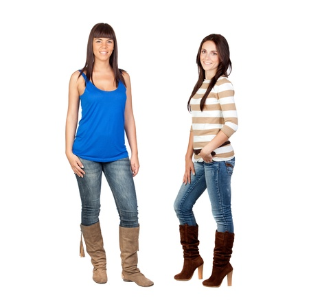 Two pretty girls with jeans isolated on a over white background photo