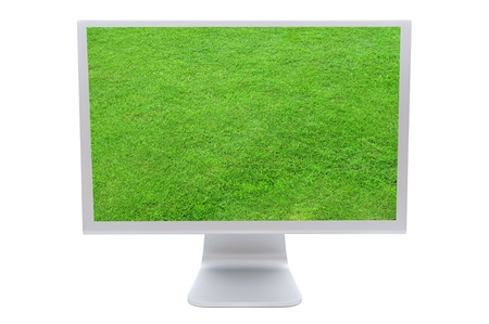 Computer monitor with the image of a green grass solated on white background  photo