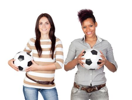 Two pretty girls with a soccer ball isolated on white background photo