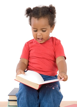 Adorable african baby reading sitting on a pile of books on a over white background