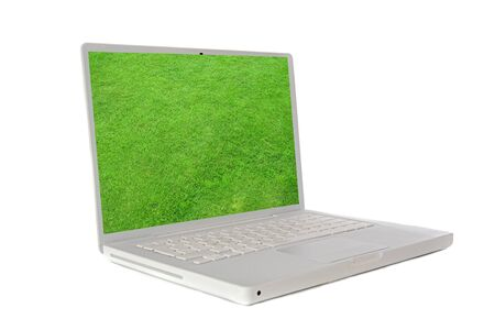 Laptop with the image of a green grass solated on white background photo