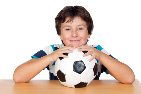 Adorable boy with a soccer ball isolated on white background photo