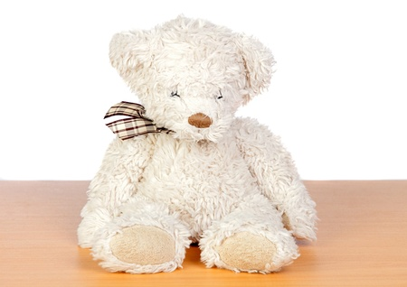 Brown teddy bear isolated on a over white background photo