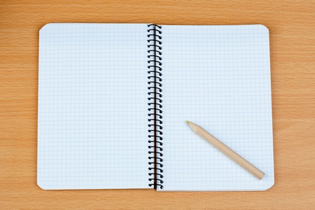 Sharp pencil on a spiral notebook in blank Stock Photo - 10491181