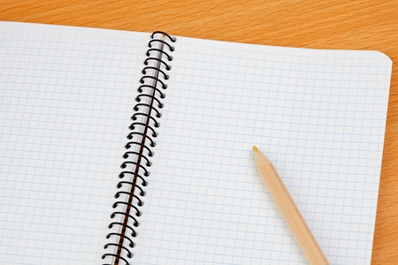 Sharp pencil on a spiral notebook in blank photo
