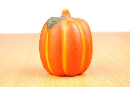 Orange pumpkin on wooden surface isolated on white background photo