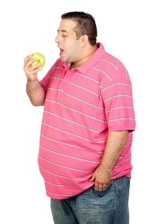 Fat man eating a apple isolated on white background photo