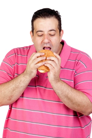 Fat man eating a hamburger isolated on white background photo