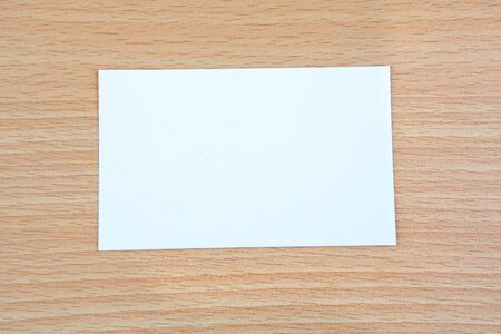White post-it stuck on a wooden surface Stock Photo - 10605827