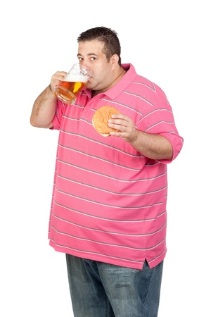 glutton: Fat man drinking a jar of beer and eating hamburger isolated on white background