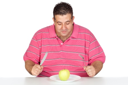 diabetes food: Fat man eating a apple isolated on white background