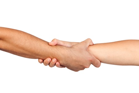 Handshake of friendship isolated on white background photo