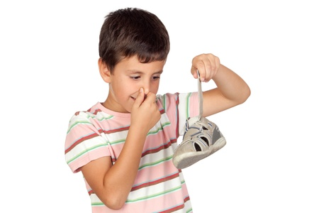 Child with a stuffy nose taking the sandal isolated on white background photo