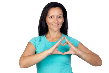 Adorable woman making a heart with the hand isolated on a over white background