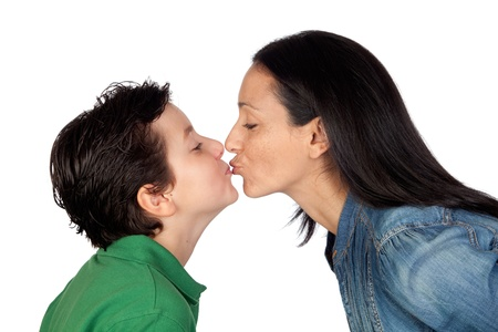 kissing lips: Adorable mother kissing her beautiful son isolated on white background Stock Photo