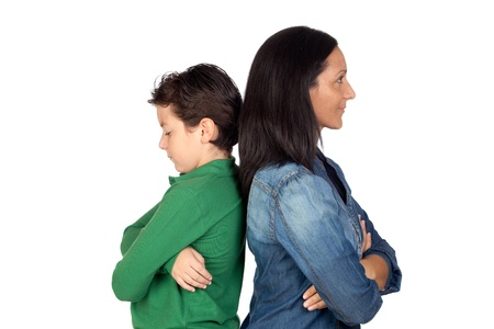 Angry mother and son isolated on white background photo