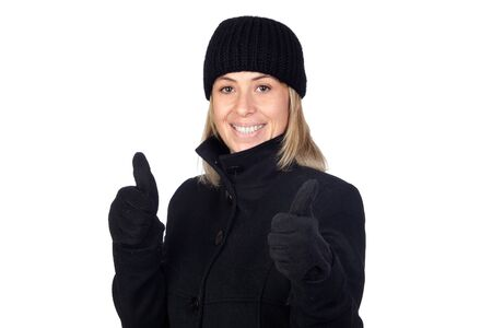 Blonde woman with a black coat saying Ok isolated on white background photo