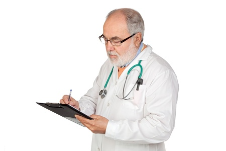 Senior doctor with clipboard isolated on white background photo