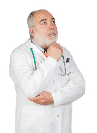 Pensive senior doctor isolated on white background Stock Photo