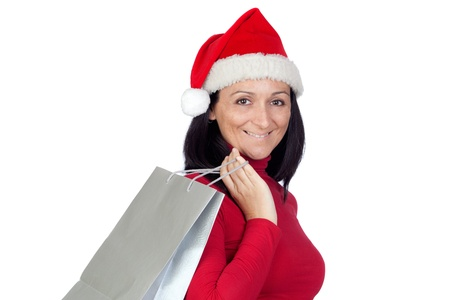 Brunette girl with Christmas hat goes shopping on a over white background photo