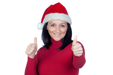 Beautiful girl with Christmas hat saying Ok on a over white background Stock Photo - 11622855