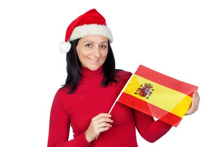 Beautiful girl with Christmas hat and spanish flag on a over white background Stock Photo - 11622862
