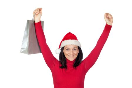 Winner girl with Christmas hat goes shopping on a over white background photo