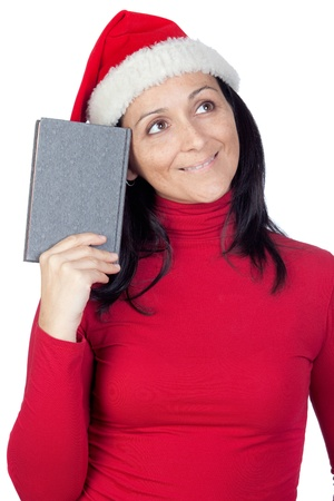 Beautiful girl with Christmas hat and a book on a over white background photo
