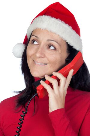 Beautiful girl with Christmas hat to phone on a over white background photo