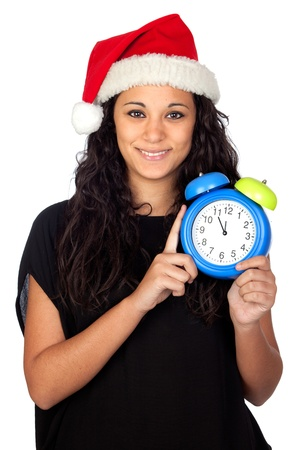 Attractive woman with Christmas hat and a clock isolated on white photo