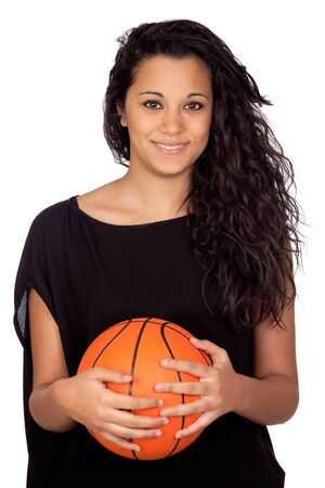 Attractive girl with a basketball isolated on white background photo
