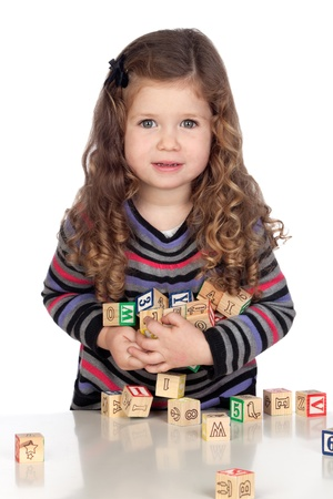 Adorable baby playing with wooden blocks isolated over white background photo