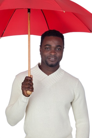 Attractive african man with a red umbrella isolated on a over white background Stock Photo - 12005131