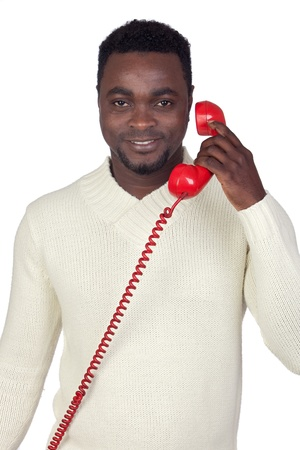 Attractive african man with a red phone isolated on a over white background photo