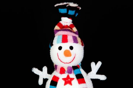 Funny snowman made of wool isolated on black background photo