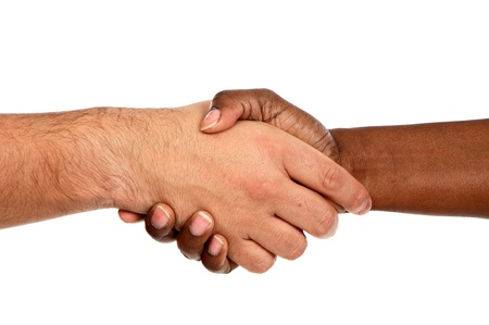 Handshake between races a over white background Stock Photo - 12373780