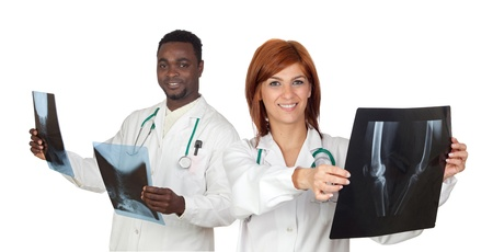 Two doctors with radiography a over white background photo