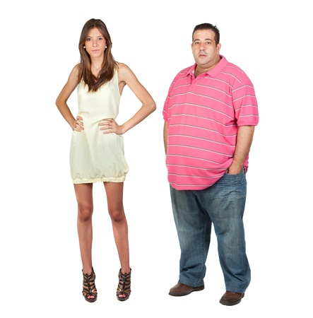 Slim girl and fat man isolated on a over white background photo